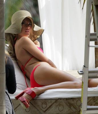 Alessandra Ambrosio modeling a red bikini