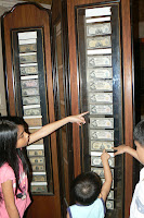 Kids inspecting the collection of paper bills in the Romualdez Museum