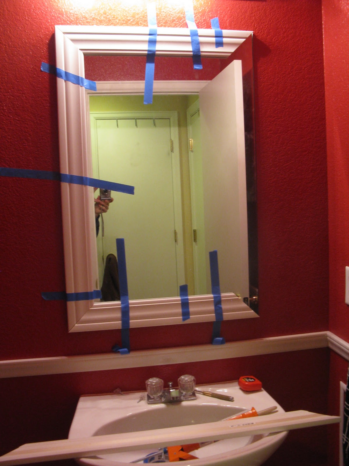 I cut my molding first and then taped to the mirror to make sure everything matched up correctly  I then used Liquid Nails to attach the molding to the. DIY  My Bathroom Redo     Inspiration For Moms