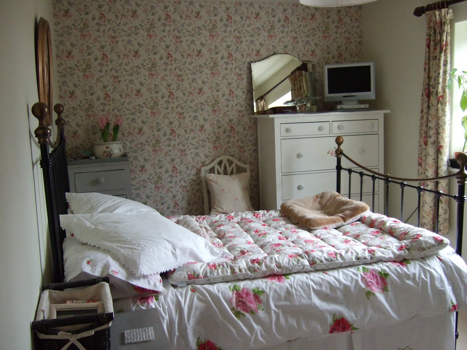 Guest room: curtains and wallpaper both in the Laura Ashley 'Melrose'