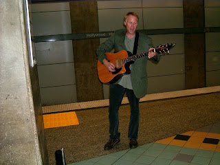 Guitar player in subway redline of Los Angeles, California