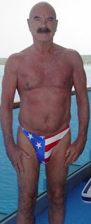 G. Gordon Liddy strikes rugged pose in good old fashioned American flag speedo - Photo courtesy of dcrtv.com