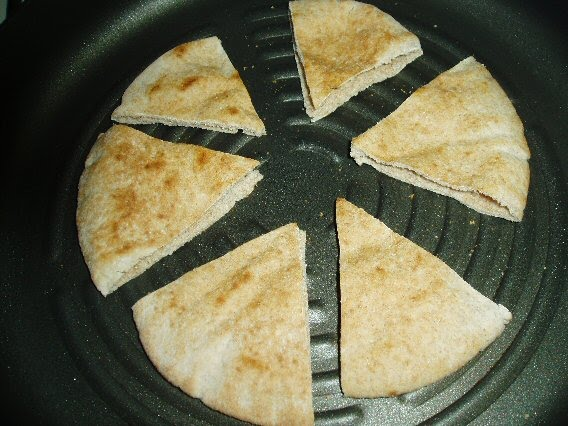grilling pita wedges in a grill pan or skillet adds a toasty richness ...
