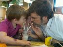 Sharing a shake with grandkids