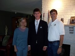Aunt and Uncle posing with Nephew before his prom