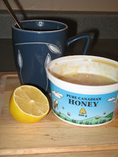 Hot water, lemon and honey sooths a sore tummy