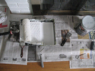 Rollers, brushes and paint for my fireplace