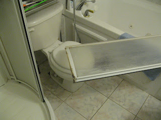 Shower door off its hinges
