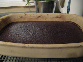 Finished chocolate cake in Pampered Chef Stoneware