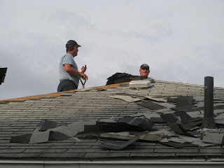 Stripping old shingles off the roof
