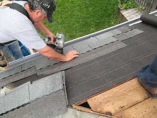 An air nailer makes the job MUCH easier and we put tar paper down first near the eaves