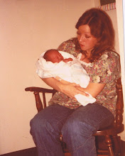 Mom holding Malena when she was 1 day old