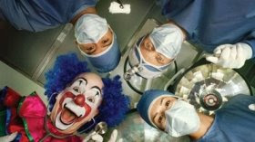 realy funny photo of your worst nightmare with a clown in surgery