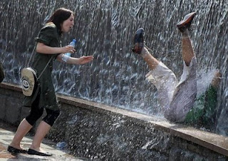 funny photos falling into water fountain