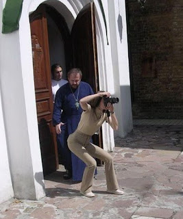 funny photos orthodox priest and woman taking picture