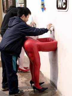 funny photo of red wash basin of womans legs and backside very rude