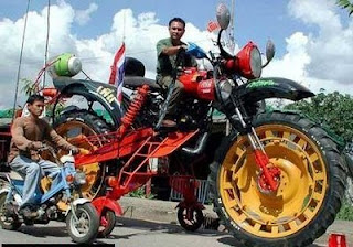 crazy funny photos huge monster bike motorbike with little scooter next to it