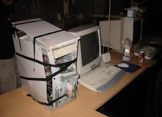 funny used computer for sale held together by tape photo