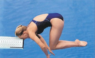 funny photo of woman making mistake diving and hitting diving board head first