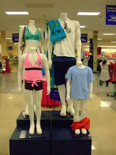 funny mannequins boy's pants pulled down by shopper photo