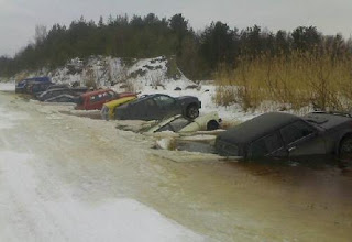 funny crazy photo of cars sinking in frozen lake after thawing