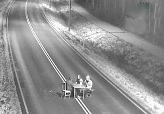 funny cctv photo of dinner party or poker gane in middle of road