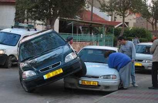 funny photo of car parked on top of another one accident good lesson in how not to park