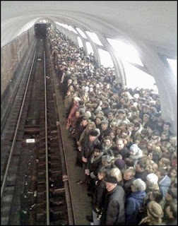 funny photo of packed subway  train platform station very dangerous