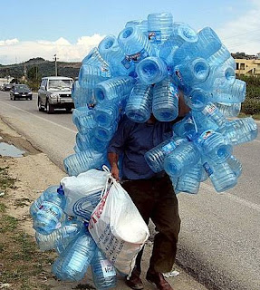 weird photo of man carrying lots of empty water bottles delivery