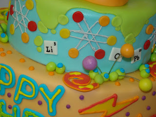 Science Theme Birthday Cakes http://sweetcakesbyrebecca.blogspot.com/2009/11/mad-science-birthday-cake.html