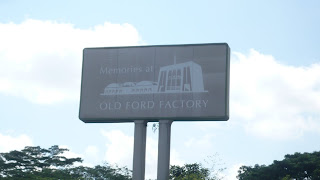 a bill board viewing from the road saying Ford Factory