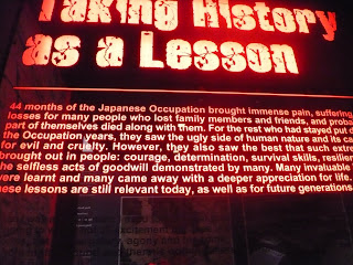 Signboard asking us to take history as lesson