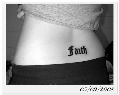 i got my very first tattoo - the word FAITH inked on my lower back as my