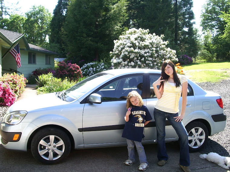 Stefanie with her car with Adriaunna and Snowy