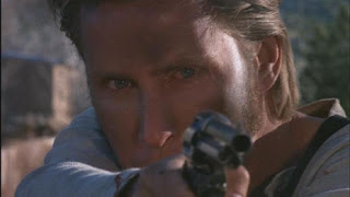 Young Guns Emilio Estevez as Billy the Kid shooting