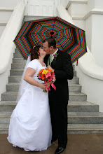 My man and I kissing in the rain on our wedding day!