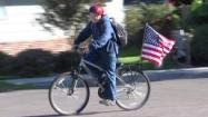 Cody - Proud american Boy - Flies Falg from Bike