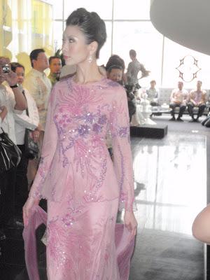 beautifully beaded baju kurung moden.