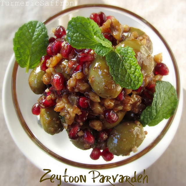... olives pomegranate seeds and walnuts combined and marinated with