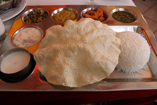 8 euro vegetarian thali at one of the Indian restaurants 'Madras café' along the Rue du Faubourg St Denis next to the Gare du Nord, paris