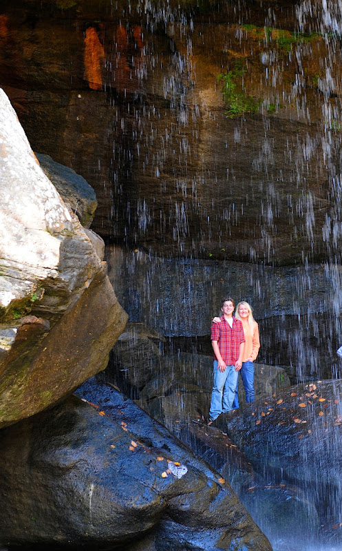 Matthew Riccetti and Kelly Riccetti under the small falls at Cumber Falls State Park in Kentucky.