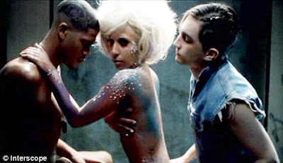 A naked Lady GaGa with male dancers in the video for her single LoveGame