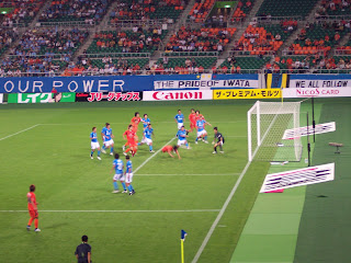 Cho Jae-Jin stoops to head home the winning goal