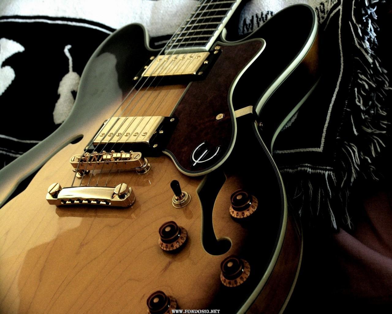 http://2.bp.blogspot.com/_yWIqiHjjNok/TP8YKgs2XhI/AAAAAAAAC74/7mJj-1DPv8I/s1600/Guitarra_Electrica.jpeg