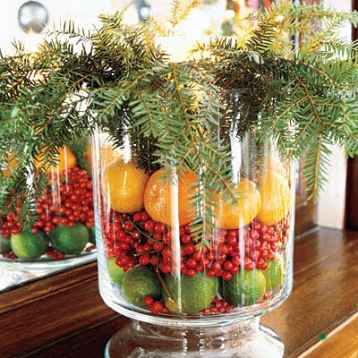 Christmas centerpiece with oranges limes and berries with pine greens