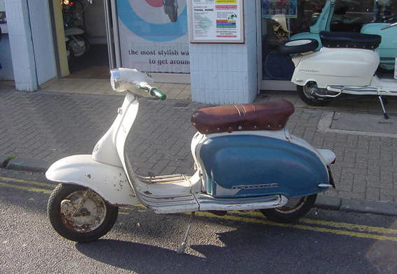 104. That Blue scooter