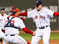 Jason Varitek congratulates Jon Lester