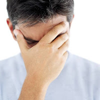 A man with a splitting headache