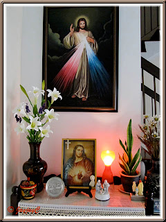 Our altar at home with images of The Divine Mercy and Sacred Heart of Jesus