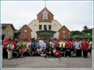 Group photo of pilgrims to the Church of St John Vianney in Tampin, Negeri Sembilan, including its Parish Priest